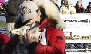 Hugh Neff hugs his lead dog, George, after, winning the Yukon Quest sled dog race.