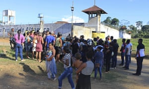 People seek information about family members who are prisoners after a riot inside the Regional Recovery Center in Altamira, Brazil.