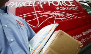 A Parcelforce worker delivering packages in London