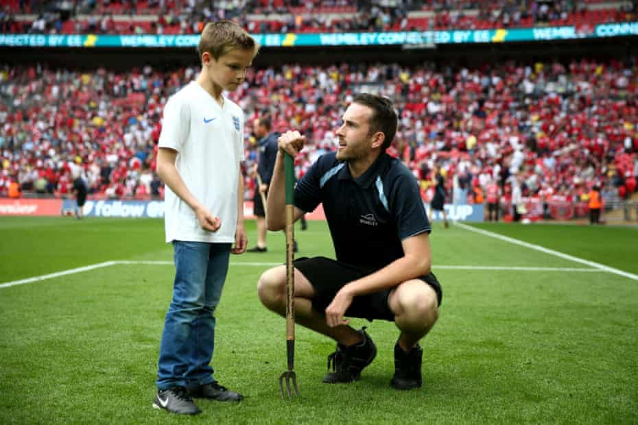 Karl Standley (kneeling) with a competition winner at Wembley stadium in 2014.