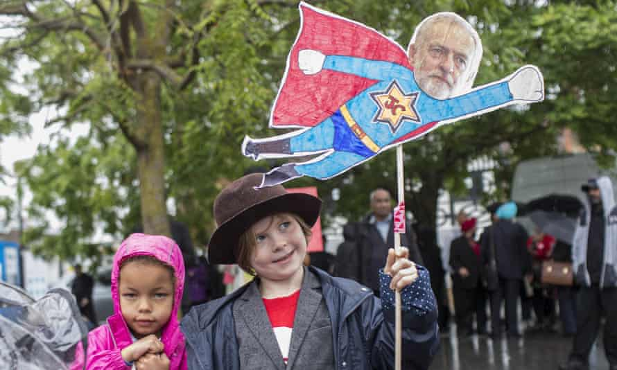 Young Jeremy Corbyn supporters with placard