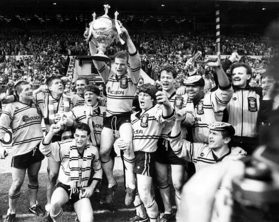 John Joyner hoists the Challenge Cup as Castleford celebrate their 15-14 victory over Hull KR in May 1986.