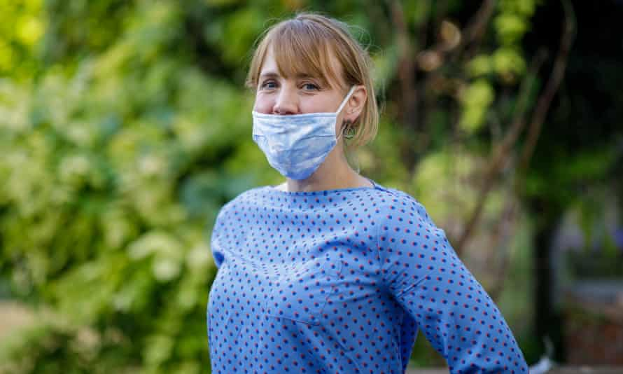 Woman wears mask over mouth, not nose