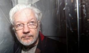 WikiLeaks' founder Julian Assange leaves Westminster magistrates court in London after a previous hearing last month.