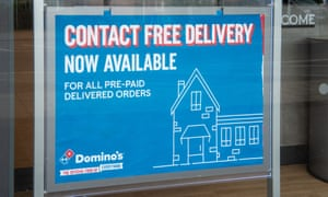 A Contact free delivery sign at Domino's Pizza in Dedworth, Windsor, Berkshire.