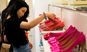 A woman shops for bright coloured shoes