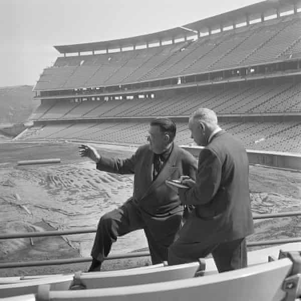 Walter F. O'Malley, left, describes features of his lavish new baseball stadium in Chavez Ravine, to sports editor Curly Grieve of the San Francisco Examiner, Feb. 22, 1962.