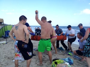 Emergency workers at the scene of a shark attack in Oak Island, North Carolina in June.