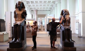Collection managers dusting statues of Amenhotep III (about 1390-1352 BC), in the Egyptian Sculpture Gallery at the British Museum.