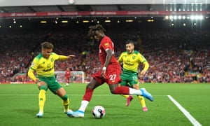 Divock Origi crosses the ball against Norwich, forcing Grant Hanley to score an own-goal that began Liverpool's march to the title.