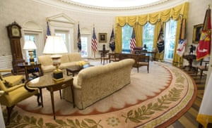 Gold-hued … the renovated Oval Office with unstripy wallpaper.
