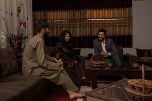 Ehsatullah Sharifi with his wife and a friend