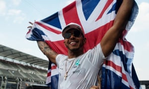 Lewis Hamilton celebrates winning the Formula One drivers' championship at the Mexican Grand Prix in October