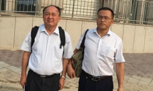 Ma Lianshun (left) and Cai Ying, two Chinese attorneys, have spent weeks searching for Li Heping, a human rights lawyer who disappeared from his home on 10 July.