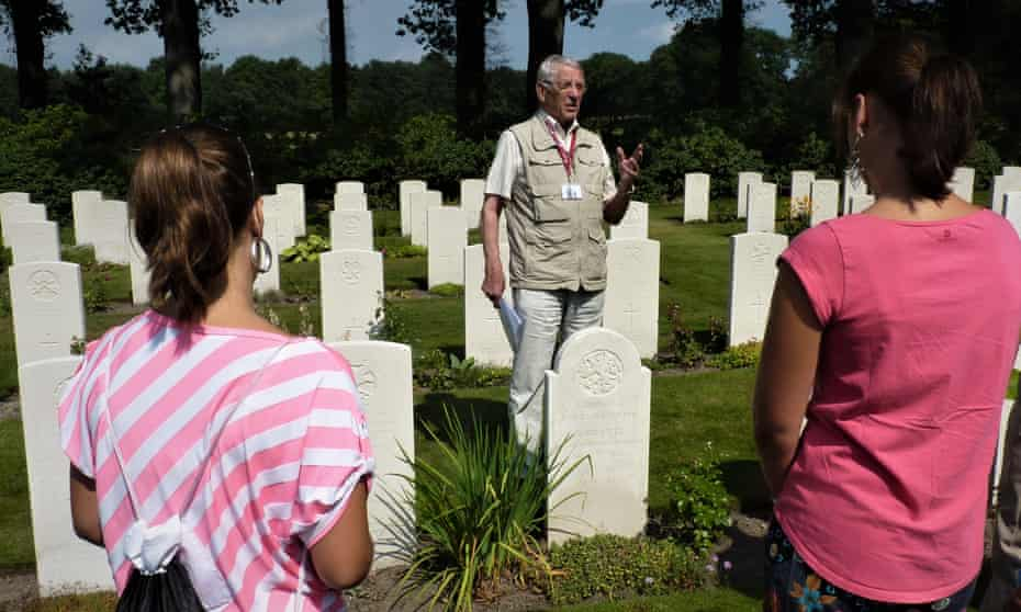 Jan Loos, from Oosterbeek talks to visitors about the second world war at the town's Airborne Museum. Netherlands.