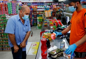 A Palestinian man shops at a mini-market in Gaza City amid restricted movement due to increasing cases of Covid-19. The new cases raised alarm bells this week in the sealed-off enclave that has weathered the pandemic relatively well so far.