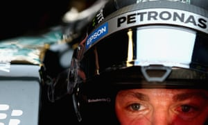 Mercedes driver Nico Rosberg sits in his car in the garage during final practice for the F1 Spanish Grand Prix