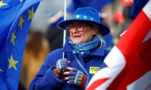 An anti-Brexit demonstrator protests outside the houses of parliament in London