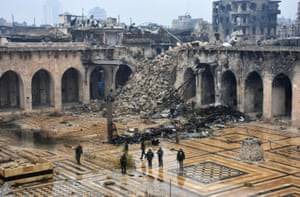 Syrian pro-government forces walking in the ancient Umayyad mosque in the old city of Aleppo