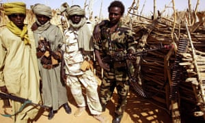 Rebels fighting Sudanese troops pose in 2004 during an intense period of fighting during the civil war.