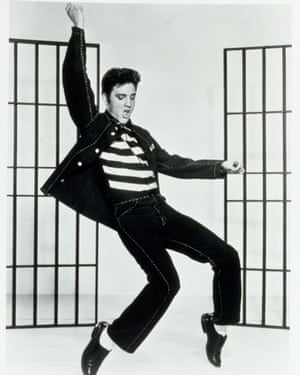"""By 1957, Presley's music career had been established, thanks to hits such as Heartbreak Hotel and Hound Dog. Jailhouse Rock, from the film of the same name, saw Elvis reprise his unapologetically sexual, hip-thrusting performance style, much to the ire of conservatives. Aesthetically, he showcased a popped collar (a future trademark), and double denim, mastering the """"Canadian tux"""" decades before it became a trend."""