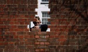 A bricklayer repairs a wall in Ashford.