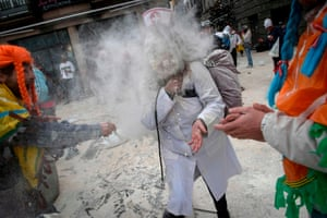 Participants throw a mixture of flour and bran during the pagan ritual