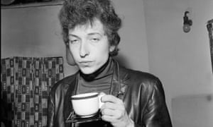 Bob Dylan with a cup of something softer – probably – in Manchester in 1966.