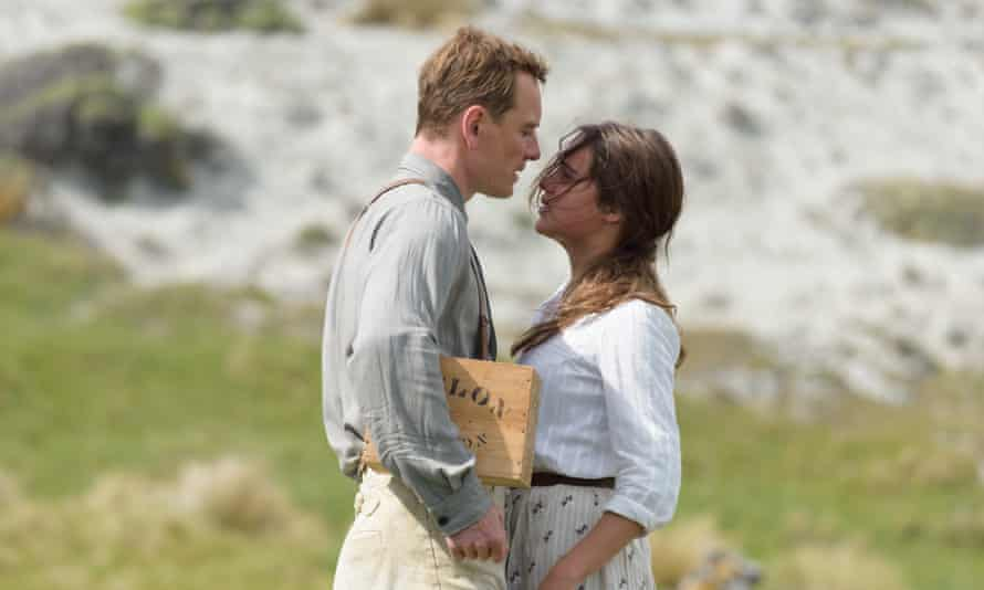 Michael Fassbender stars as Tom Sherbourne and Alicia Vikander as his wife Isabel in The Light Between Oceans.