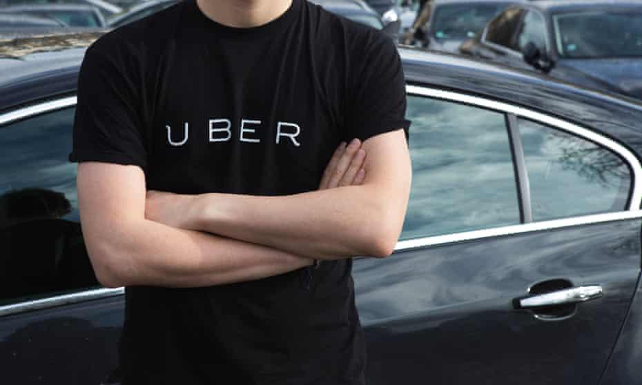 A man in an Uber T-shirt