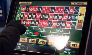Someone using a FOBT