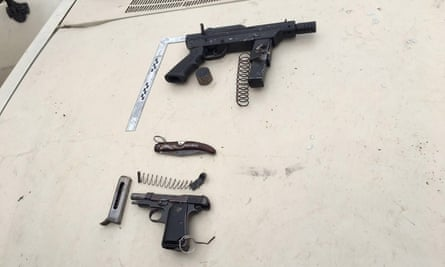Two weapons seized after an attack on Israeli soldiers on Monday at the entrance to the Israeli settlement at Kiryat Arba. The machine pistol (above) is the variant of the homemade 'Carl Gustav' submachine gun.