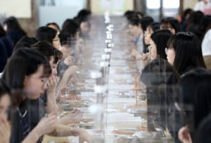 Daejeon, South Korea. Students sit behind protective screens to eat their lunch as high schools in the country reopen