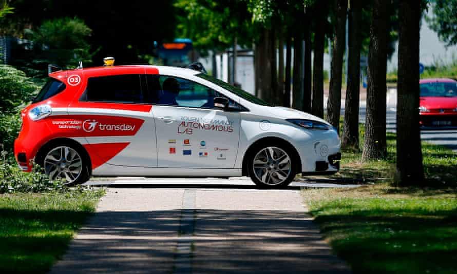 An autonomous car drives past on a street in France.