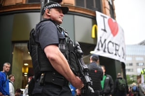 Armed police patrol the streets during the Great Manchester Run.