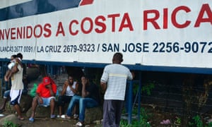 Migrants by a banner that reads 'Welcome to Costa Rica' in an encampment of Africans in Peñas Blancas, Guanacaste, Costa Rica, on the border with Nicaragua last month.