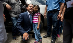 immy Morales, the favourite to win Guatemala's presidential election, poses for photos with a child after voting in the first round at a polling station in Mixco on 6 September.