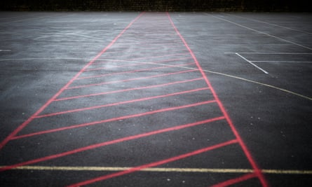 Red markings separate different year groups while in the school playground.