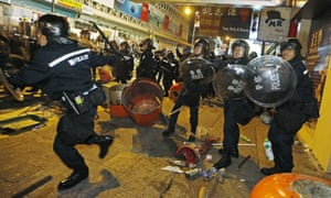 Chaos … riot police in the Mong Kok district of Hong Kong.