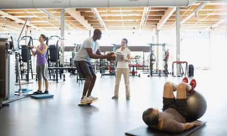 Physical therapist guiding patient with medicine ball gym