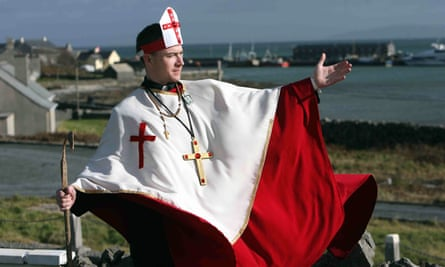A man dressed up as a bishop takes part in an event at Tedfest, the annual celebration of the TV comedy Father Ted, on Inishmore, Ireland.