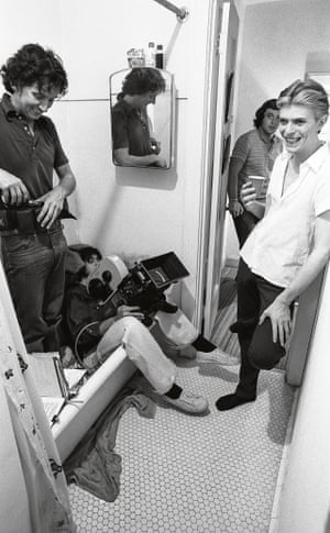 David Bowie on set with camera crew.