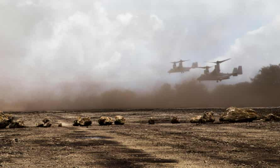 Two US Marine Corps aircraft participate in a military exercise in 2014 in Tinian.