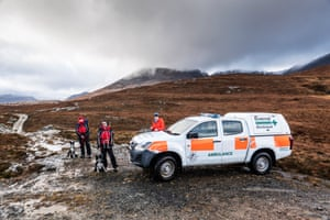 Alison Smith and her collie Meg, with Steve Worsley and his dog Rona, alongside the Dundonnell mountain rescue team ambulance.