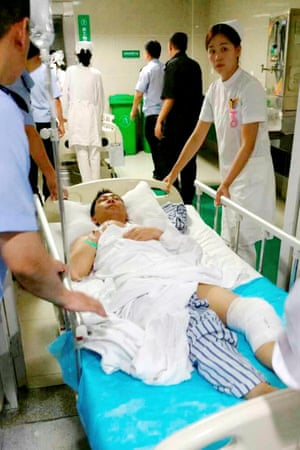 An injured passenger is rescued from the capsized cruise ship was taken to the People's Hospital of Jianli county in Jingzhou City, Hubei.