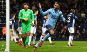 Ayoze Pérez of Newcastle United celebrates after Jonny Evans of West Bromwich Albion scores an own goal
