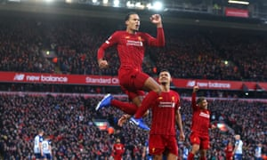 Virgil Van Dijk celebrates scoring at Anfield.