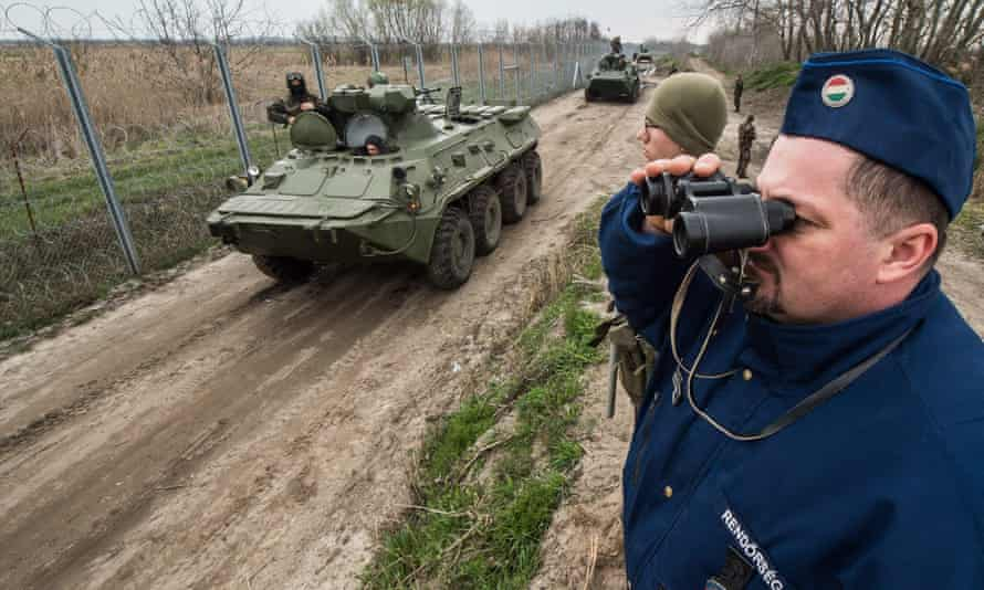 Hungarian troops on patrol earlier this year along the border fence Hungary erected to stop migrants and refugees.
