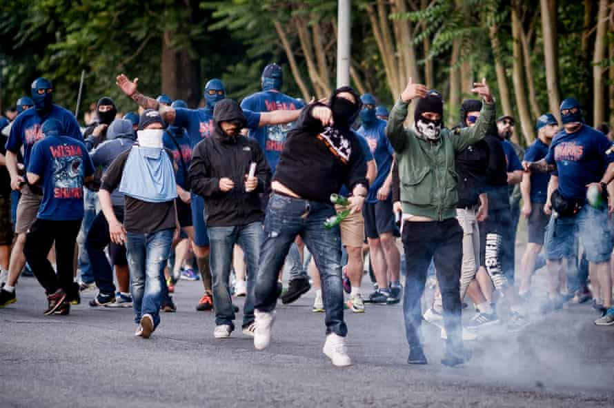 SS Lazio ultras clash with riot police at the end of the Serie A match between SS Lazio and AS Roma in 2015.