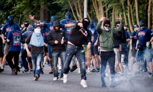 Lazio's ultra clash with riot police at the end of the derby match against Roma.